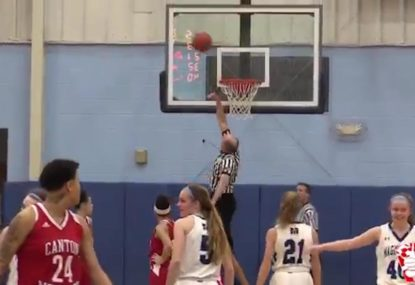 Referee shows off his vertical leap after ball gets stuck in hoop