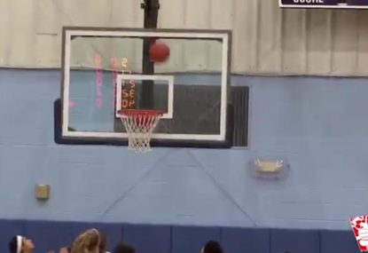 Basketball gets bizarrely wedged in hoop after physics-defying bounce
