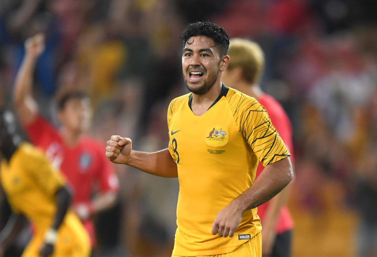 Massimo Luongo celebrates scoring for the Socceroos