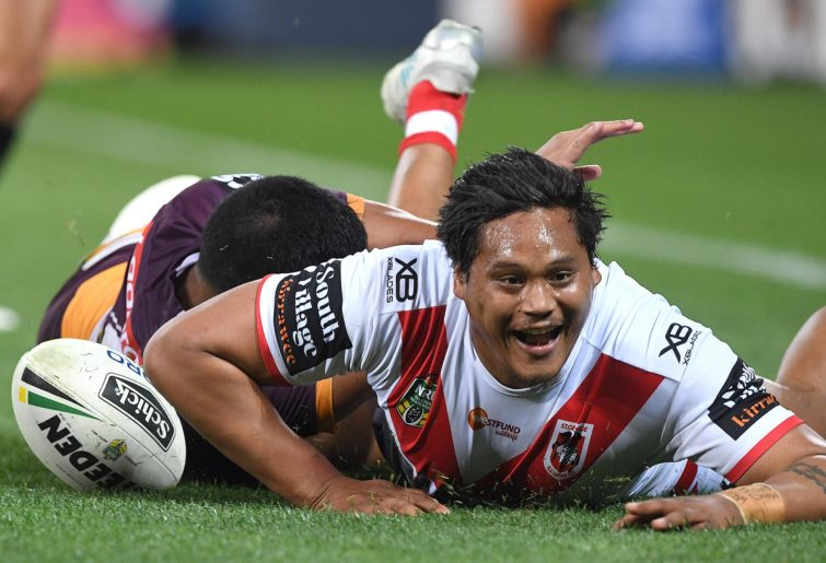 Luciano Leilua of the Dragons scores a try.