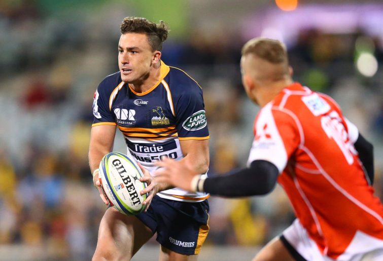 Tom Banks runs the ball for the Brumbies