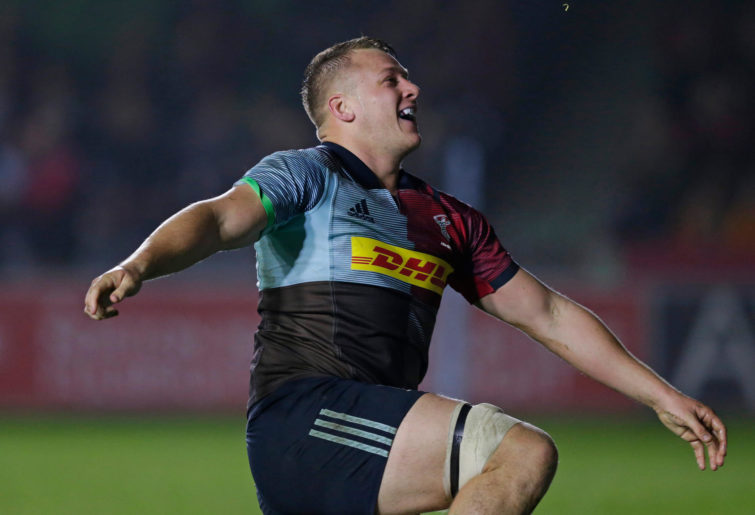 Alex Dombrandt of Harlequins celebrates scoring his side's first try