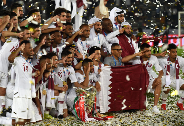Qatar players celebrate their Asian Cup win.