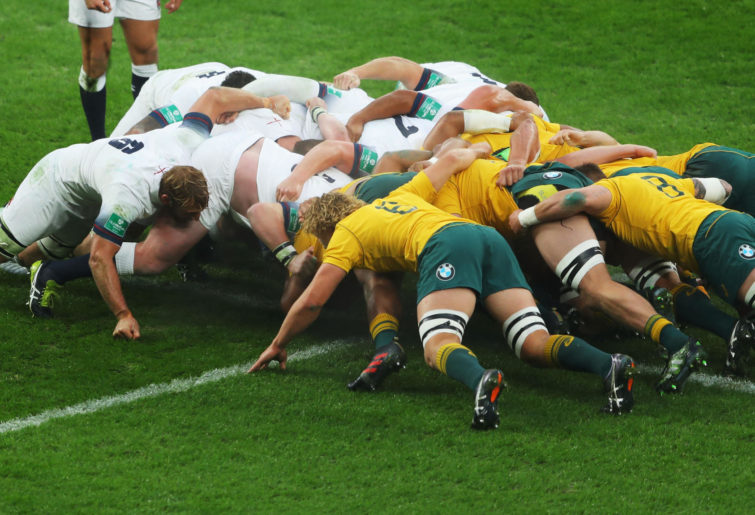 Wallabies and England players scrum.