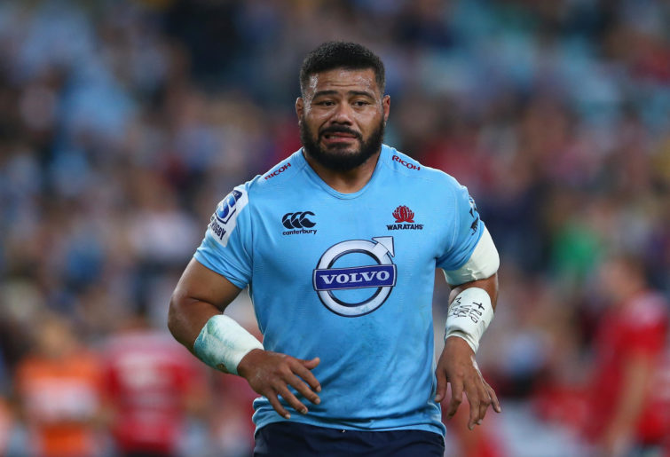 Tolu Latu of the Waratahs leaves the field