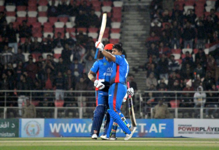 Hazratullah Zazai celebrates a record-breaking scoring run during Afghanistan's T20 match against Ireland.
