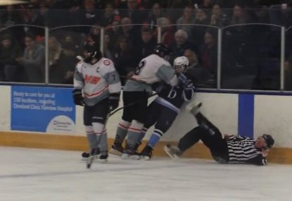 Ice hockey referee gets taken out by two warring players