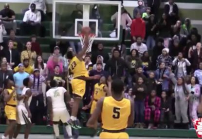 Monster highschool one-handed dunk sends crowd into meltdown!