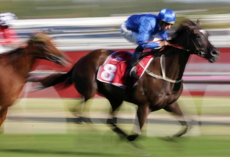Jockey Hugh Bowman rides Avilius to victory