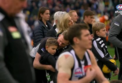 Touching moment between Collingwood coach and his son after heartbreaking GF loss
