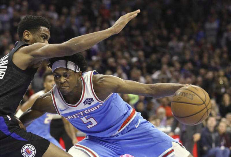 Los Angeles Clippers guard Shai Gilgeous-Alexander, left, tries to stop the drive of Sacramento Kings guard De'Aaron Fox during the second half of an NBA basketball game in Sacramento, Calif., Friday, March 1, 2019. The Clippers won 116-109. (AP Photo/Rich Pedroncelli)