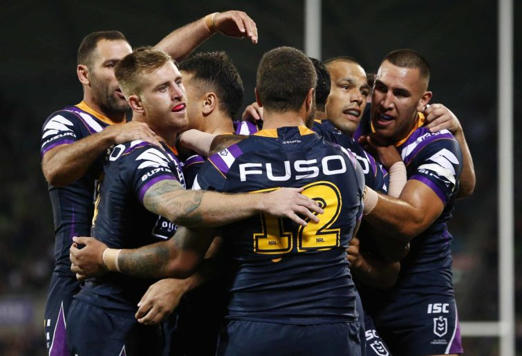 Storm players celebrate a Jahrome Hughes try