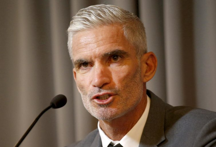 Craig Foster addresses journalists in Thailand.