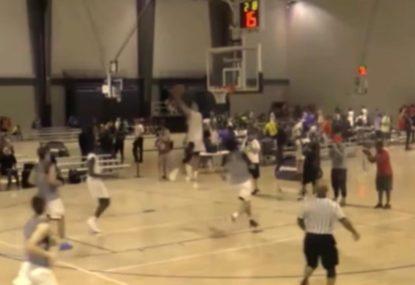 Basketball prodigy casually jams epic WINDMILL dunk