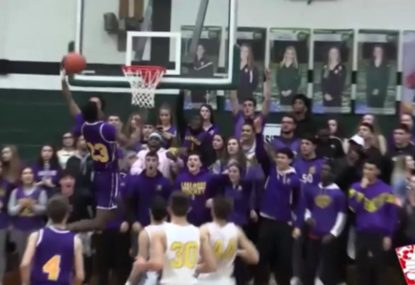 Monster one-handed highschool dunk sends home crowd wild