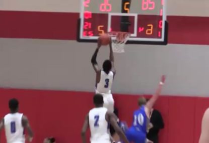 Baller jams stylish two-hand dunk on the fastbreak