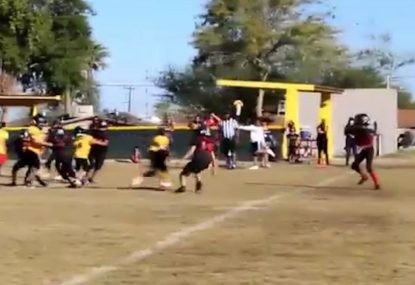 Smallest kid on the field steamrolls opposition for epic touchdown