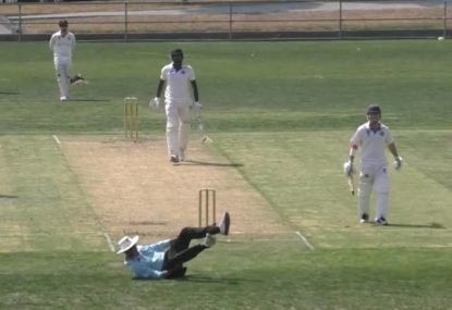 Umpire comically takes a tumble trying to duck huge drive