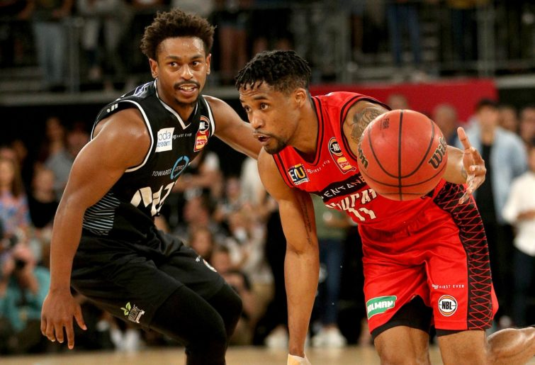 Wildcat Bryce Cotton contests with Melbourne's Casper Ware