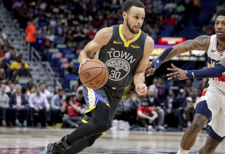 steph curry drives past a defender