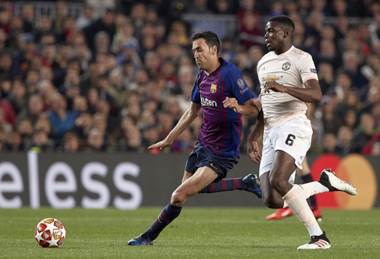 Sergio Busquets clashes with Paul Pogba.