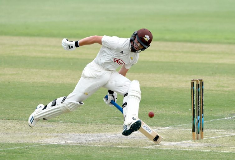 Ollie Pope of Surrey picks up a run