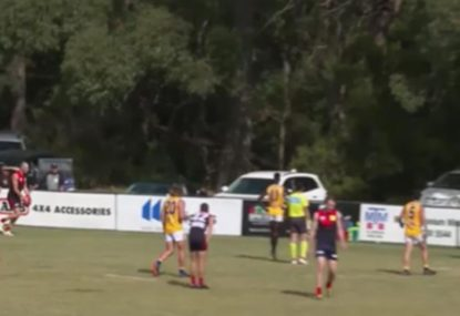 Footballer stuffs up simple set shot, kicks into man on the mark
