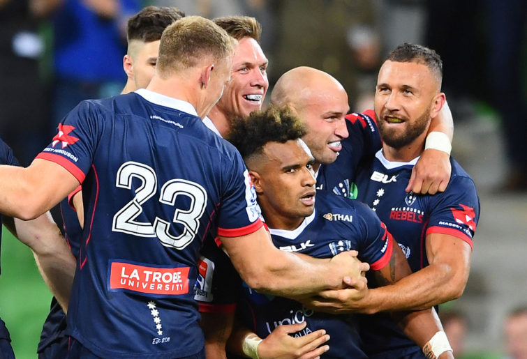 Rebels players, including Will Genia and Quade Cooper, celebrate