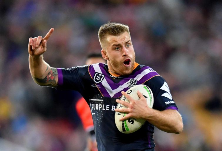 Cameron Munster runs with the ball.