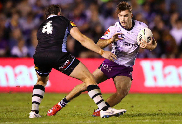 Ryan Papenhuyzen runs the ball up against Cronulla Sharks and the Melbourne Storm at Shark Park.