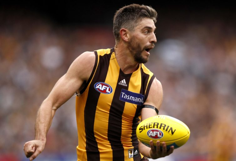 Ricky Henderson of the Hawks handpasses the ball during the Round 5 AFL match between the Hawthorn Hawks and the Geelong Cats at the MCG in Melbourne, Monday, April 22, 2019. (AAP Image/Daniel Pockett)