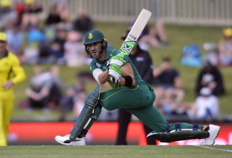 Faf du Plessis plays a sweep shot