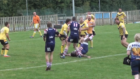 Brutal stiff arm tackle on stocky opponent