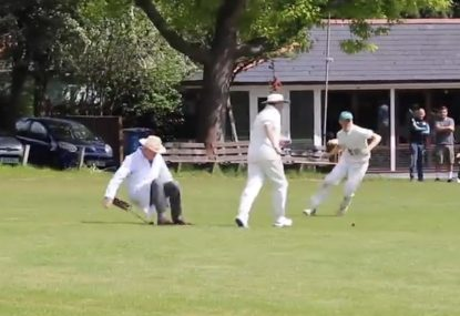 Sitting square leg umpire gets bowled over by a fielder