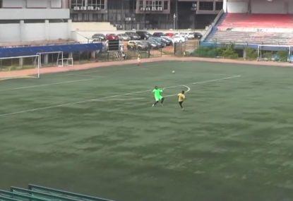Striker sneaks HUGE long-range lob over charging keeper in heart-stopping goal