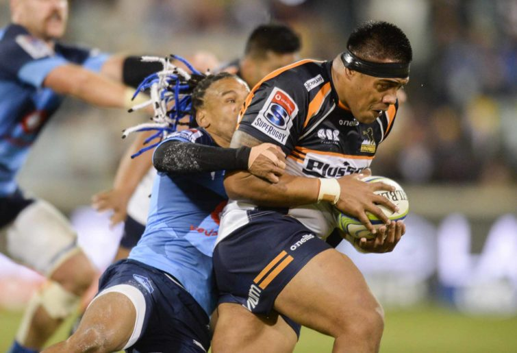 Allan Alaalatoa of the Brumbies is tackled by Rosko Specman of the Bulls