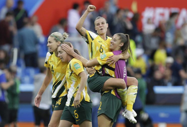 The Matildas celebrate.
