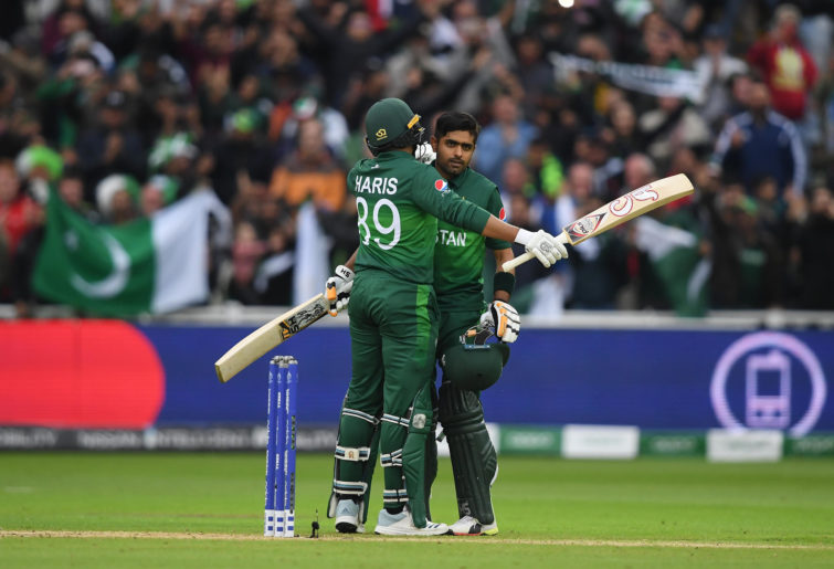 Babar Azam and Haris Sohail celebrate Pakistan's win.