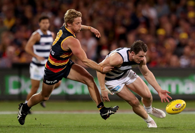 Rory Sloane chases Patrick Dangerfield