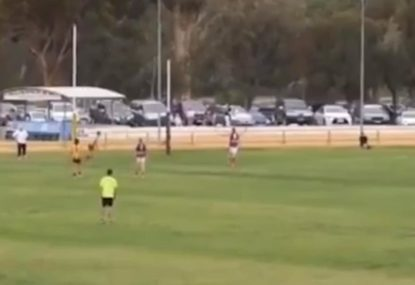 Aussie Rules fullback launches arguably the longest torpedo ever from the goal square