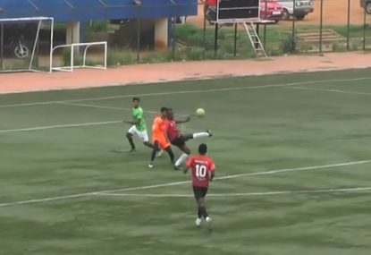 Striker pulls off freakish bicycle kick over keeper and defender's head