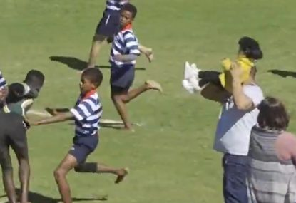 Spectator saves tiny child from being trampled by try-scoring run