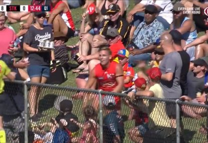 Peak suburban footy as Sun gets shoved over the fence and into the crowd