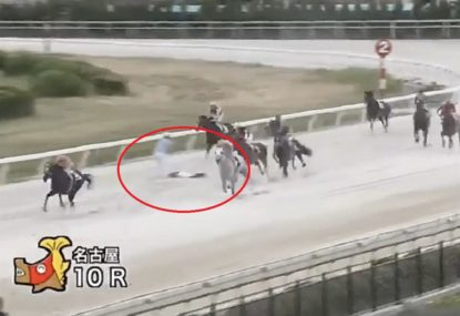 Scary scenes as race continues with unconscious jockey on track