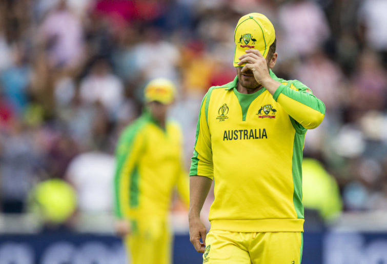 Aaron Finch leaves the field looking dejected.