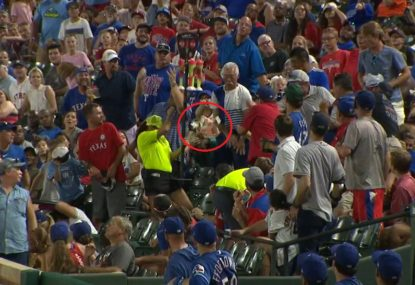 Baseball fan discovers why it's a bad idea to attempt a catch with a wallet