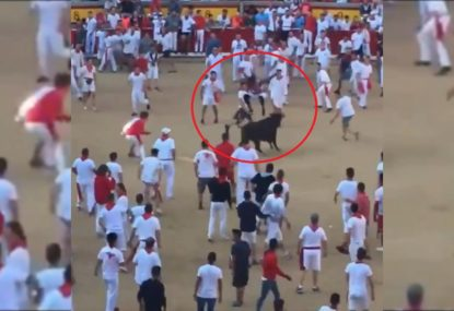 NFL player doesn't just run with the bulls – he leaps over one!