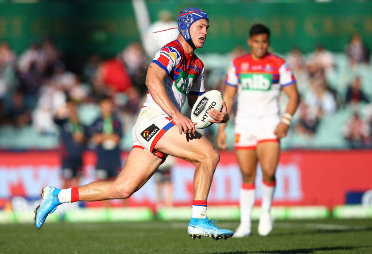 Kalyn Ponga runs the ball for the Knights.