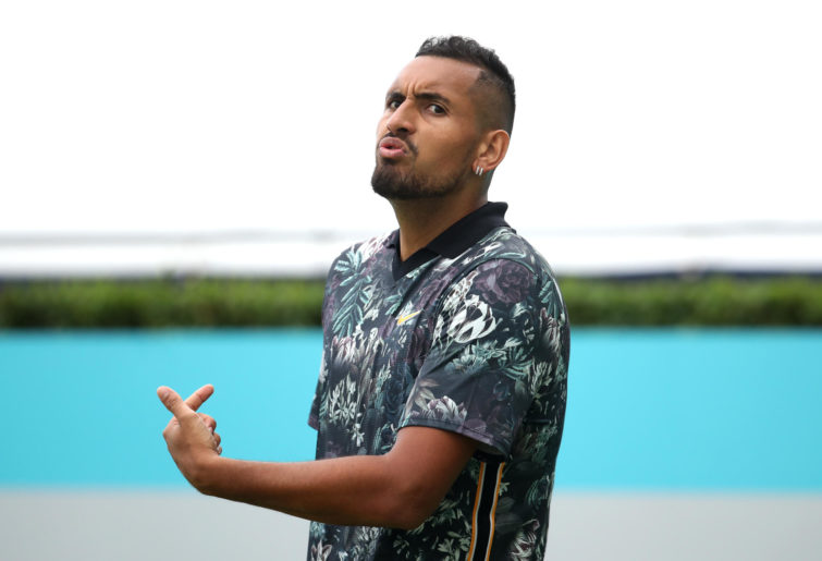 Nick Kyrgios reacts to a point.