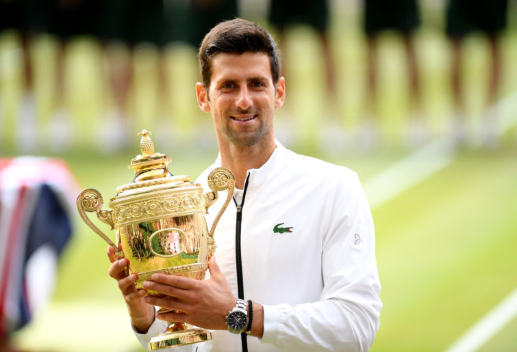 Novak Djokovic with the 2019 Wimbledon trophy.